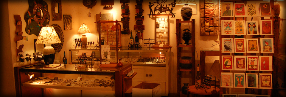 Wall art, greeting cards, jewelry items on display in Hartland, Wisconsin shop